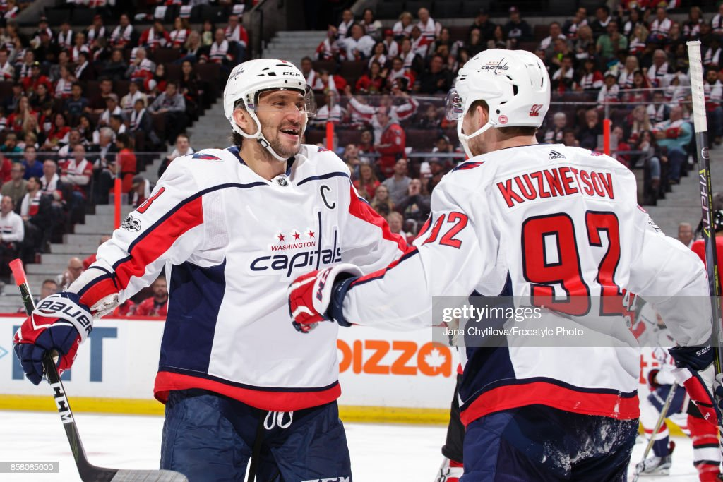 Alex Ovechkin #8 of the Washington Capitals celebrates his third period goal and second of the game against the Ottawa Senators with teammate Evgeny Kuznetsov #92 at Canadian Tire Centre on October 5, 2017 in Ottawa, Ontario, Canada.