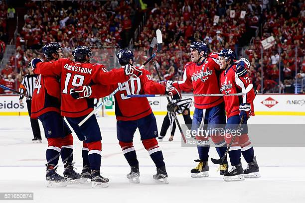 Alex Ovechkin of the Washington Capitals celebrates scoring a second period goal with teammates against the Philadelphia Flyers in Game Two of the...