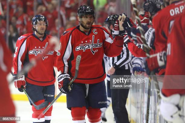 Alex Ovechkin of the Washington Capitals celebrates teammate Justin Williams goal against the Toronto Maple Leafs in the first period in Game One of...