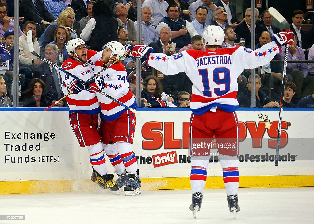 Alex Ovechkin #8 of the Washington Capitals celebrates wiith teammate John Carlson #74 and Nicklas Backstrom #19 after scoring a goal in the first peroid against the New York Rangers in Game Seven of the Eastern Conference Semifinals during the 2015 NHL Stanley Cup Playoffs at Madison Square Garden on May 13, 2015 in New York City.