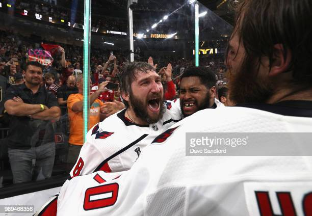 Alex Ovechkin of the Washington Capitals celebrates winning the Stanley Cup with teammates goaltender Devante SmithPelly and Braden Holtby after...