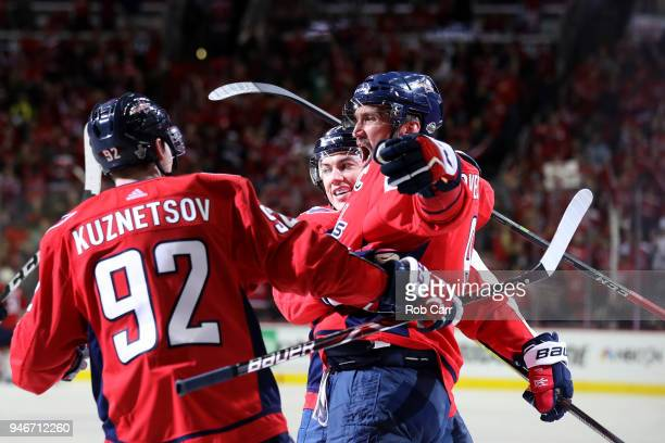 Alex Ovechkin of the Washington Capitals celebrates with Evgeny Kuznetsov after scoring a goal in the second period against the Columbus Blue Jackets...