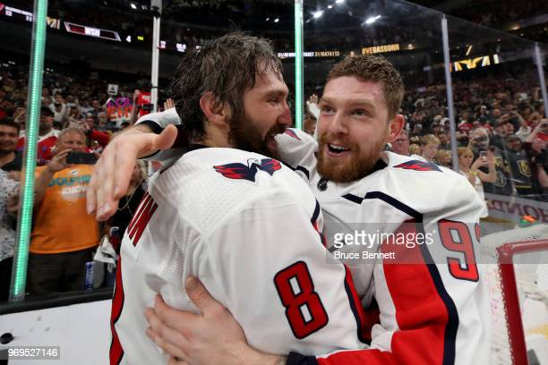 Alex Ovechkin of the Washington Capitals celebrates with Evgeny Kuznetsov after their team defeated the Vegas Golden Knights 43 in Game Five of the...