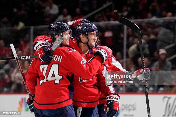 Alex Ovechkin of the Washington Capitals celebrates with his teammates after scoring a goal against the Montreal Canadiens in the first period at...