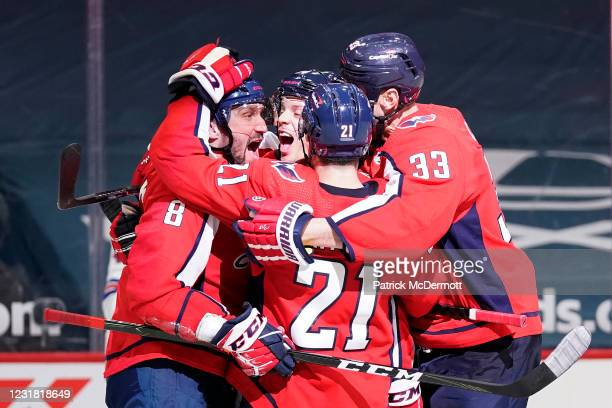 Alex Ovechkin of the Washington Capitals celebrates with his teammates after scoring his second goal of the game against the New York Rangers in the...