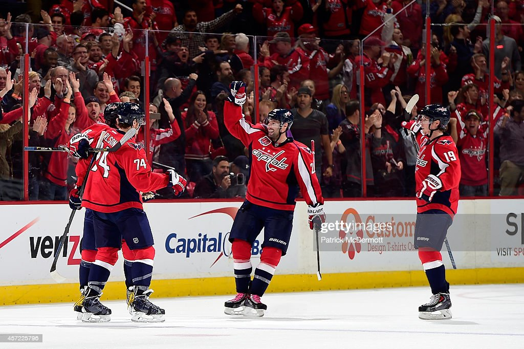 Alex Ovechkin #8 of the Washington Capitals celebrates with his teammates after scoring a goal in the third period against the San Jose Sharks during an NHL game at Verizon Center on October 14, 2014 in Washington, DC.