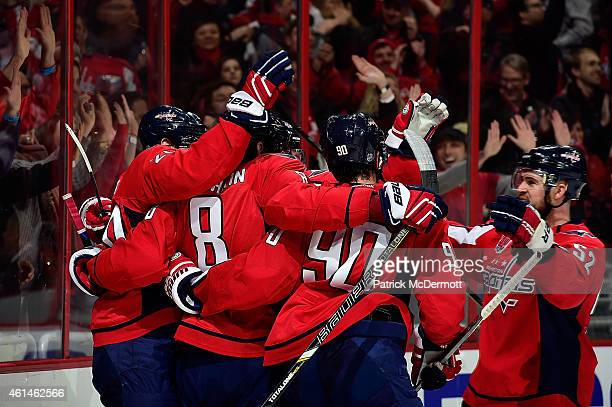 Alex Ovechkin of the Washington Capitals celebrates with his teammates after scoring a goal in the second period against the Colorado Avalanche...