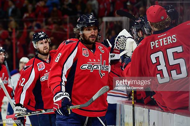 Alex Ovechkin of the Washington Capitals celebrates with his teammates after scoring his second goal of the game in the first period during an NHL...