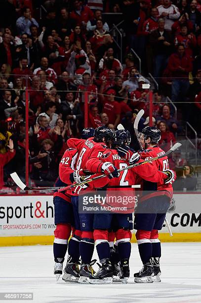 Alex Ovechkin of the Washington Capitals celebrates with his teammates after scoring a goal in the first period during an NHL game against the New...