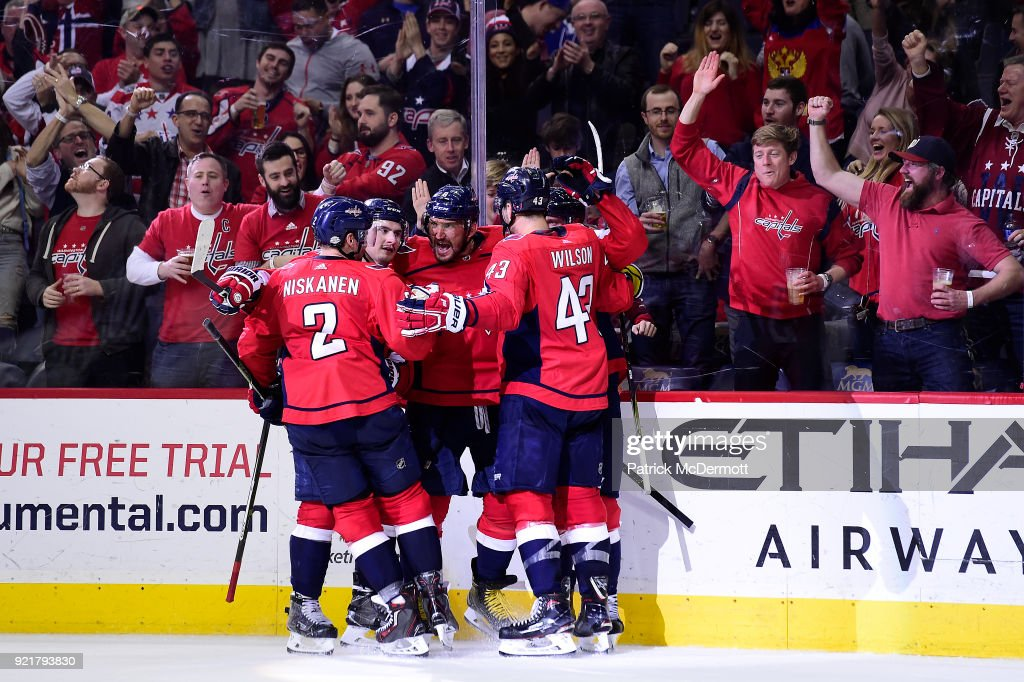 Alex Ovechkin #8 of the Washington Capitals celebrates with his teammates after scoring a third period goal against the Tampa Bay Lightning at Capital One Arena on February 20, 2018 in Washington, DC.