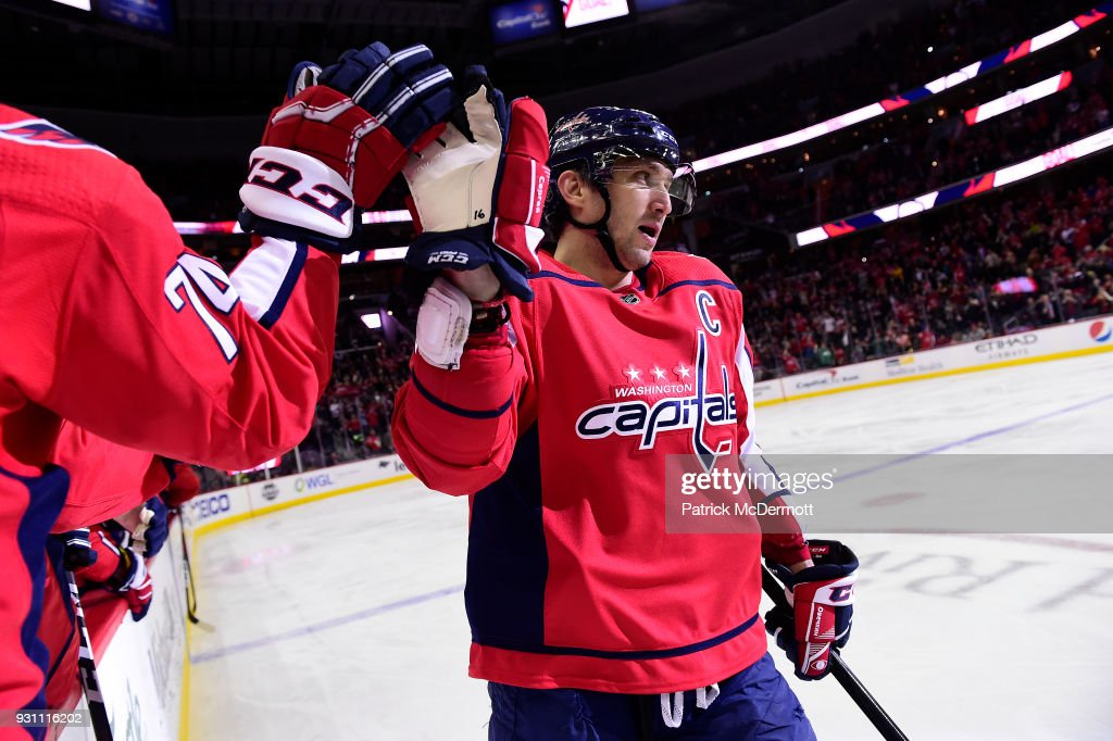 Alex Ovechkin #8 of the Washington Capitals celebrates with his teammates after scoring his 600th career NHL goal during the second period against the Winnipeg Jets at Capital One Arena on March 12, 2018 in Washington, DC.