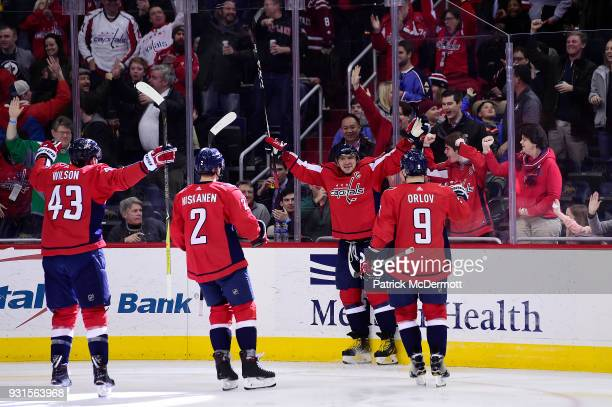 Alex Ovechkin of the Washington Capitals celebrates with his teammates after scoring his 600th career NHL goal during the second period against the...