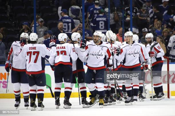 Alex Ovechkin of the Washington Capitals celebrates with his teammates after defeating the Tampa Bay Lightning in Game One of the Eastern Conference...