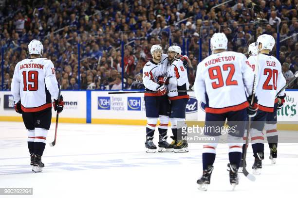 Alex Ovechkin of the Washington Capitals celebrates with his teammates after scoring a goal on Andrei Vasilevskiy of the Tampa Bay Lightning during...