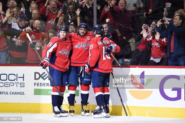 Alex Ovechkin of the Washington Capitals celebrates with his teammates Christian Djoos and Nicklas Backstrom after scoring his third goal of the game...