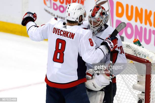 Goalie Braden Holtby and TJ Oshie of the Washington Capitals celebrate the win against the Tampa Bay Lightning after Game One of the Eastern...