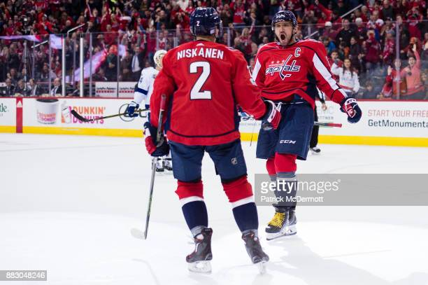 Alex Ovechkin of the Washington Capitals celebrates with Matt Niskanen after scoring a first period goal against the Tampa Bay Lightning at Capital...