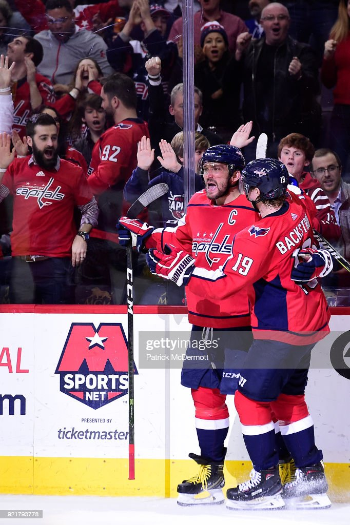 Alex Ovechkin #8 of the Washington Capitals celebrates with Nicklas Backstrom #19 after scoring a third period goal against the Tampa Bay Lightning at Capital One Arena on February 20, 2018 in Washington, DC.