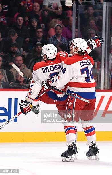 Alex Ovechkin of the Washington Capitals celebrates with teammate John Carlson after scoring his 473rd career goal in the second period to pass Peter...