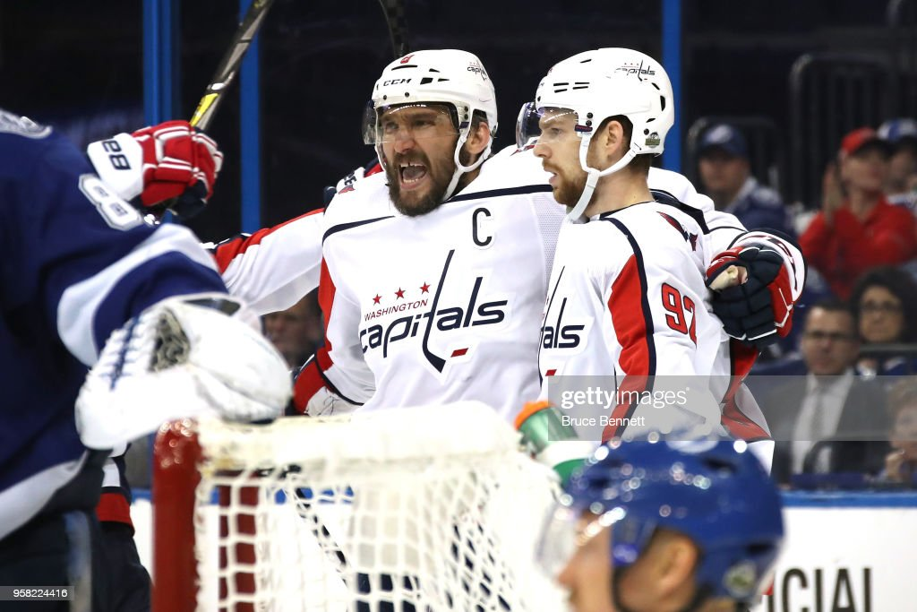 Alex Ovechkin #8 of the Washington Capitals celebrates with teammate Evgeny Kuznetsov #92 after scoring a goal against Andrei Vasilevskiy #88 of the Tampa Bay Lightning during the third period in Game Two of the Eastern Conference Finals during the 2018 NHL Stanley Cup Playoffs at Amalie Arena on May 13, 2018 in Tampa, Florida.
