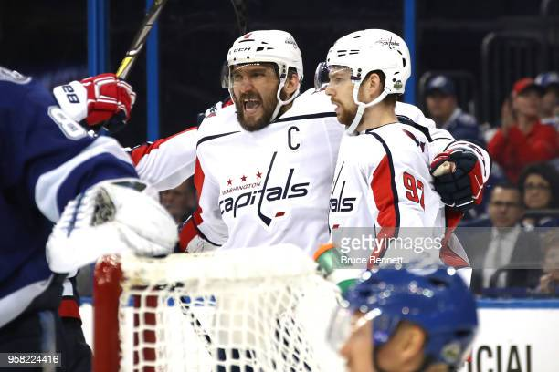 Alex Ovechkin of the Washington Capitals celebrates with teammate Evgeny Kuznetsov after scoring a goal against Andrei Vasilevskiy of the Tampa Bay...