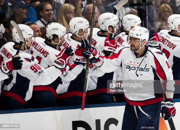 Alex Ovechkin of the Washington Capitals celebrates with teammates after scoring on the Toronto Maple Leafs during the first period in Game Three of...