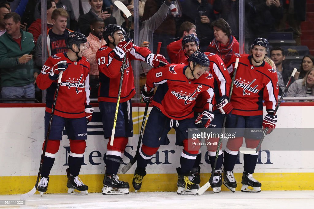 Alex Ovechkin #8 of the Washington Capitals celebrates with teammates after scoring his 600th career goal against the Winnipeg Jets during the second period at Capital One Arena on March 12, 2018 in Washington, DC.