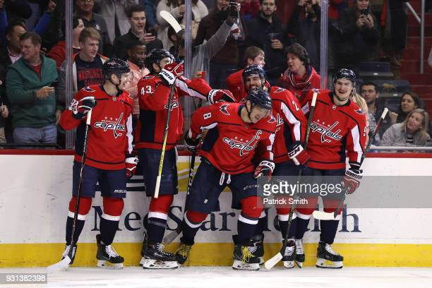 Alex Ovechkin of the Washington Capitals celebrates with teammates after scoring his 600th career goal against the Winnipeg Jets during the second...