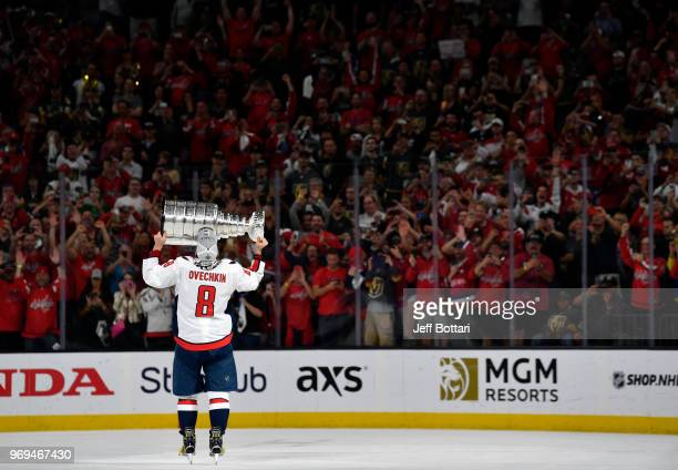 Alex Ovechkin of the Washington Capitals celebrates with the Stanley Cup after defeating the Vegas Golden Knights in Game Five of the Stanley Cup...