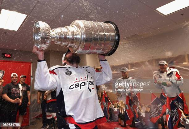 Alex Ovechkin of the Washington Capitals celebrates with the Stanley Cup in the locker room after the Capitals defeated the Vegas Golden Knights 43...