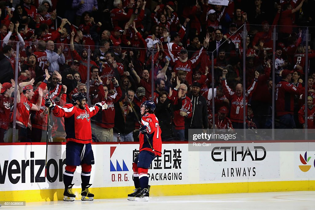 Alex Ovechkin #8 of the Washington Capitals (L) celebrates with T.J. Oshie #77 after scoring a goal for his 1000th career point against the Pittsburgh Penguins in the first period at Verizon Center on January 11, 2017 in Washington, DC.