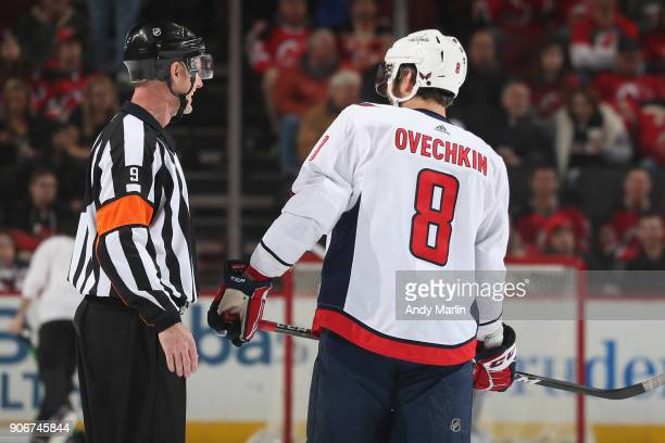 Alex Ovechkin of the Washington Capitals chats with Referee Dan O'Rourke during the game against the New Jersey Devils at Prudential Center on...