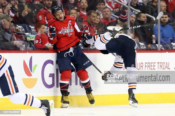 Alex Ovechkin of the Washington Capitals checks Darnell Nurse of the Edmonton Oilers during the third period at Capital One Arena on November 5 2018...