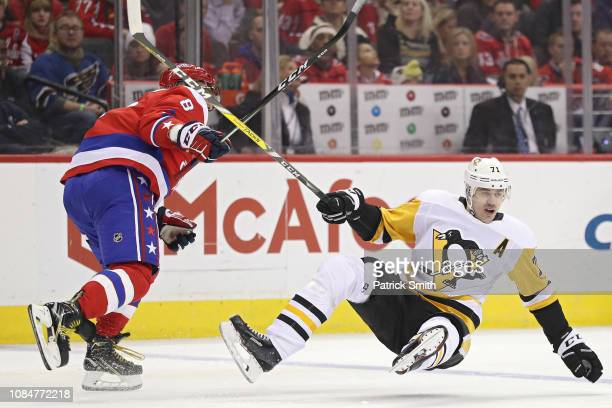 Alex Ovechkin of the Washington Capitals checks Evgeni Malkin of the Pittsburgh Penguins during the third period at Capital One Arena on December 19...