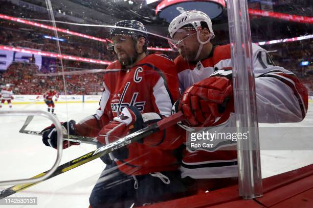 Alex Ovechkin of the Washington Capitals checks Justin Williams of the Carolina Hurricanes in Game Two of the Eastern Conference First Round during...