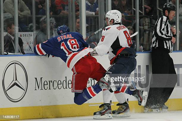 Alex Ovechkin of the Washington Capitals checks Marc Staal of the New York Rangers in Game One of the Eastern Conference Semifinals during the 2012...