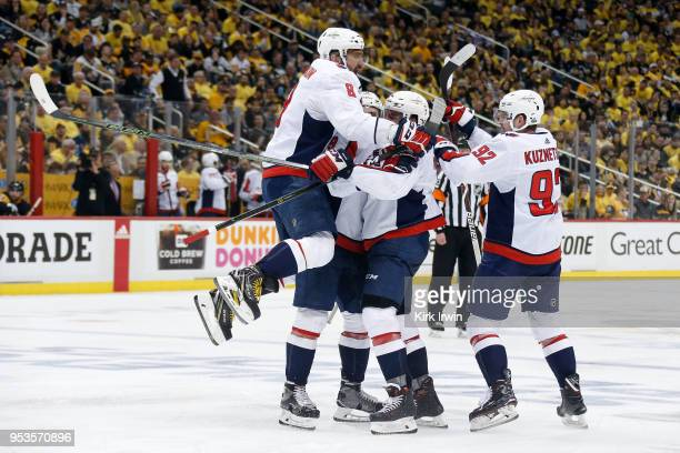 Alex Ovechkin of the Washington Capitals congratulates Matt Niskanen of the Washington Capitals after scoring a goal during the third period in Game...