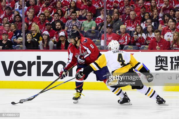 Alex Ovechkin of the Washington Capitals controls the puck against Justin Schultz of the Pittsburgh Penguins in the third period in Game Two of the...