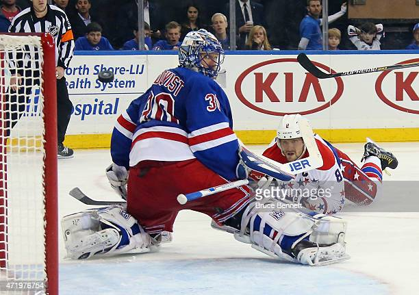 Alex Ovechkin of the Washington Capitals dives and scores a third period goal against Henrik Lundqvist of the New York Rangers in Game Two of the...