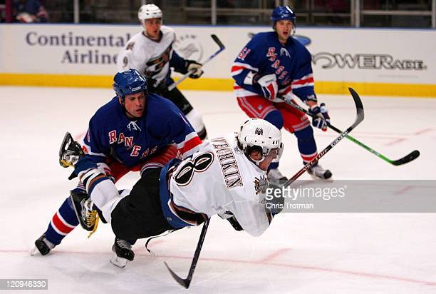 Alex Ovechkin of the Washington Capitals dives following a collision with Aaron Ward of the New York Rangers during the Rangers home opener at...