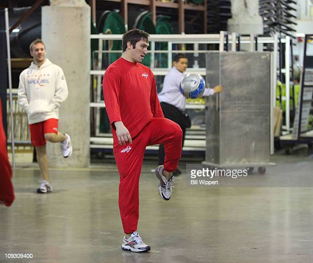 Alex Ovechkin of the Washington Capitals draws the attention of teammate Scott Hannan and an arena worker while warming up to play the Buffalo Sabres...