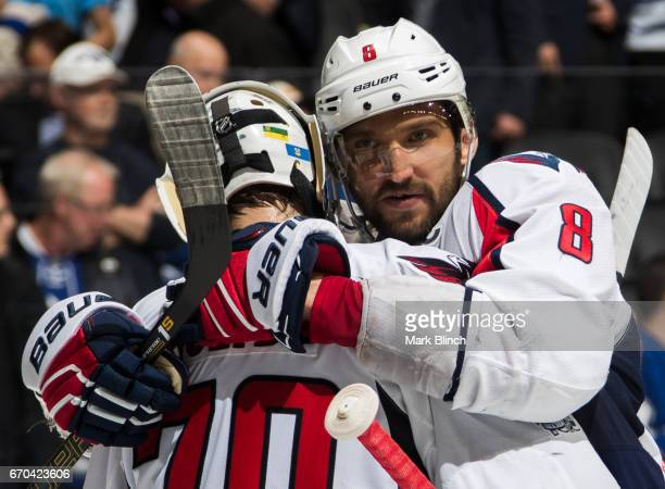 Alex Ovechkin of the Washington Capitals embraces Braden Holtby after the Capitals defeated the Toronto Maple Leafs during the third period in Game...