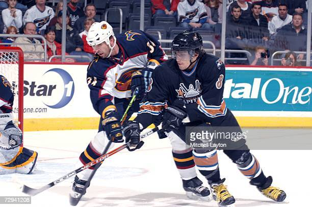 Alex Ovechkin of the Washington Capitals fights for a puck during a NHL hockey game against Shane Hnidy of the Atlanta Thrashers at the Verizon...