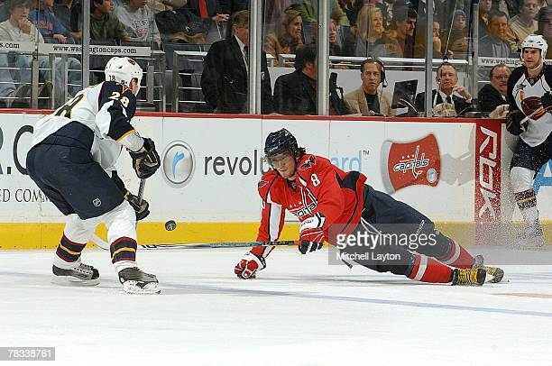 Alex Ovechkin of the Washington Capitals fights for loss puck during a hockey game against Niclas Havelid of the Atlanta Thrashers on December 8 2007...