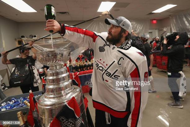 Alex Ovechkin of the Washington Capitals fills up the Stanley Cup in the locker room after the Capitals defeated the Vegas Golden Knights 43 in Game...