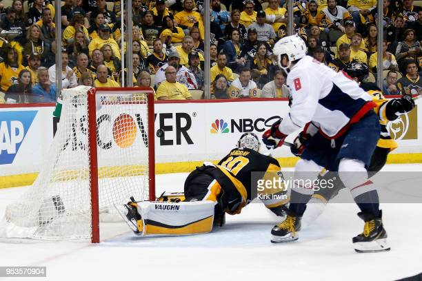 Alex Ovechkin of the Washington Capitals flips the puck past Matt Murray of the Pittsburgh Penguins for the game winning goal during the third period...