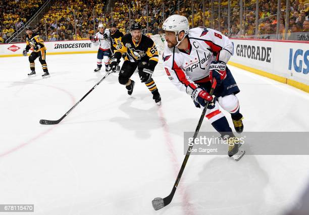 Alex Ovechkin of the Washington Capitals handles the puck against Ron Hainsey of the Pittsburgh Penguins in Game Four of the Eastern Conference...