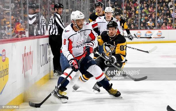 Alex Ovechkin of the Washington Capitals handles the puck in front of Sidney Crosby of the Pittsburgh Penguins at PPG Paints Arena on February 2 2018...