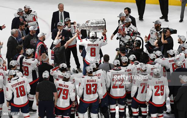 Alex Ovechkin of the Washington Capitals hands the Stanley Cup off after the team's 43 win over the Vegas Golden Knights in Game Five of the 2018 NHL...