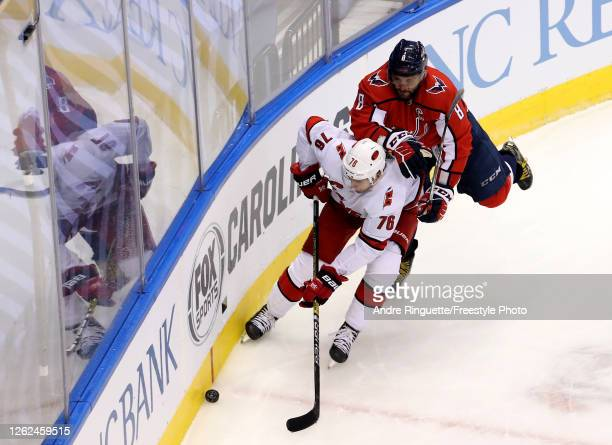 Alex Ovechkin of the Washington Capitals hits Brady Skjei of the Carolina Hurricanes in the third period during an exhibition game prior to the 2020...